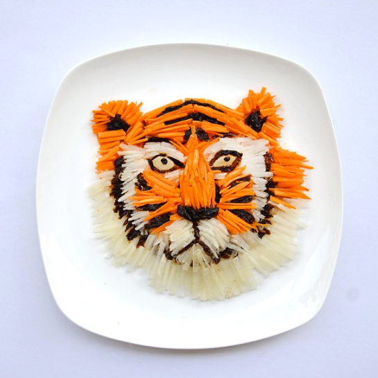 """""Hello there, Richard Parker!"" Tiger made of chopped carrots, white radish and prunes. Serve with a drizzle of olive oil and a zigzag of balsamic glaze and voila! A fun plate of salad!"""